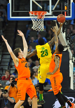 March 20, 2015: Oregon Ducks forward Elgin Cook (23) gets a layup during a second round game between No. 8 Oregon and No. 9 Oklahoma State in the 2015 NCAA Men's Basketball Championship Tournament at CenturyLink Center in Omaha, Neb. Oregon defeated Oklahoma State 79-73.
