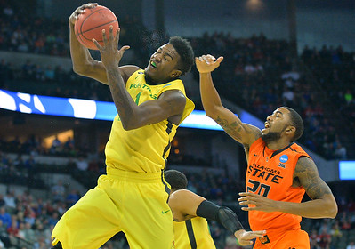 March 20, 2015: Oregon Ducks forward Jordan Bell (1) grabs a rebound during a second round game between No. 8 Oregon and No. 9 Oklahoma State in the 2015 NCAA Men's Basketball Championship Tournament at CenturyLink Center in Omaha, Neb. Oregon defeated Oklahoma State 79-73.