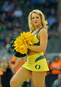 March 20, 2015: An Oregon Ducks cheerleader performs during a second round game between No. 8 Oregon and No. 9 Oklahoma State in the 2015 NCAA Men's Basketball Championship Tournament at CenturyLink Center in Omaha, Neb. Oregon defeated Oklahoma State 79-73.