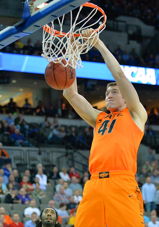 March 20, 2015: Oklahoma State Cowboys forward/center Mitchell Solomon (41) gets a dunk during a second round game between No. 8 Oregon and No. 9 Oklahoma State in the 2015 NCAA Men's Basketball Championship Tournament at CenturyLink Center in Omaha, Neb. Oregon defeated Oklahoma State 79-73.
