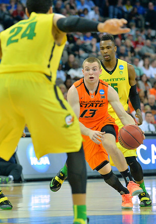 March 20, 2015: Oklahoma State Cowboys guard Phil Forte III (13) dribbles into the paint during a second round game between No. 8 Oregon and No. 9 Oklahoma State in the 2015 NCAA Men's Basketball Championship Tournament at CenturyLink Center in Omaha, Neb. Oregon defeated Oklahoma State 79-73.