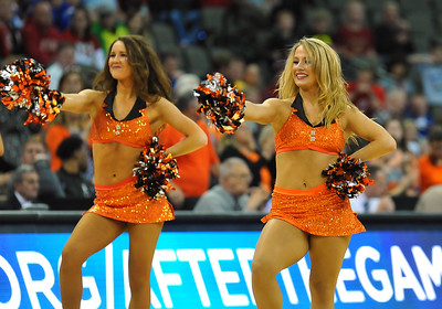 March 20, 2015: Oklahoma State Cowboys cheerleaders perform during a second round game between No. 8 Oregon and No. 9 Oklahoma State in the 2015 NCAA Men's Basketball Championship Tournament at CenturyLink Center in Omaha, Neb. Oregon defeated Oklahoma State 79-73.
