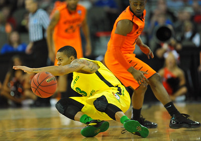 March 20, 2015: Oregon Ducks guard Joseph Young (3) stumbles during a second round game between No. 8 Oregon and No. 9 Oklahoma State in the 2015 NCAA Men's Basketball Championship Tournament at CenturyLink Center in Omaha, Neb. Oregon defeated Oklahoma State 79-73.