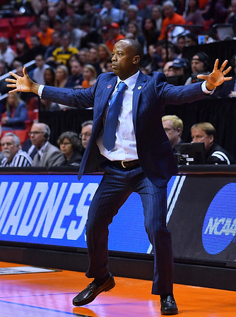 SAN DIEGO, CA - MARCH 16:  Charleston Cougars head coach Earl Grant reacts on the sideline during a first round game of the Men's NCAA Basketball Tournament against the Auburn Tigers at Viejas Arena in San Diego, California. Auburn won 62-58.  (Photo by Sam Wasson)