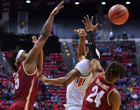 SAN DIEGO, CA - MARCH 16:  Auburn Tigers forward Horace Spencer (0) passes against forward Jarrell Brantley (5) and Charleston Cougars forward Jaylen McManus (24) during a first round game of the Men's NCAA Basketball Tournament at Viejas Arena in San Diego, California. Auburn won 62-58.  (Photo by Sam Wasson)