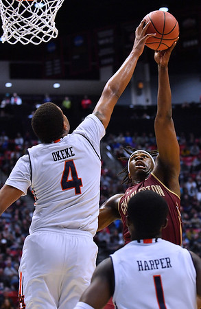 SAN DIEGO, CA - MARCH 16:  Auburn Tigers forward Chuma Okeke (4) blocks a shot attempt from Charleston Cougars forward Jarrell Brantley (5) during a first round game of the Men's NCAA Basketball Tournament at Viejas Arena in San Diego, California. Auburn won 62-58.  (Photo by Sam Wasson)
