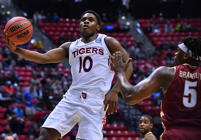 SAN DIEGO, CA - MARCH 16:  Auburn Tigers guard Davion Mitchell (10) shoots against Charleston Cougars forward Jarrell Brantley (5) during a first round game of the Men's NCAA Basketball Tournament at Viejas Arena in San Diego, California. Auburn won 62-58.  (Photo by Sam Wasson)