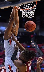 SAN DIEGO, CA - MARCH 16:  Auburn Tigers forward Desean Murray (13) dunks against Charleston Cougars forward Jaylen McManus (24) during a first round game of the Men's NCAA Basketball Tournament at Viejas Arena in San Diego, California. Auburn won 62-58.  (Photo by Sam Wasson)