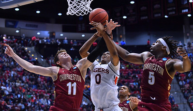 SAN DIEGO, CA - MARCH 16:  Auburn Tigers forward Horace Spencer (0) battles for a rebound against Charleston Cougars forward Evan Bailey (11) and Cougars forward Jarrell Brantley (5) during a first round game of the Men's NCAA Basketball Tournament at Viejas Arena in San Diego, California. Auburn won 62-58.  (Photo by Sam Wasson)