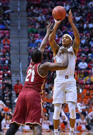 SAN DIEGO, CA - MARCH 16:  Auburn Tigers guard Bryce Brown (2) shoots against Charleston Cougars guard Marquise Pointer (21) during a first round game of the Men's NCAA Basketball Tournament at Viejas Arena in San Diego, California. Auburn won 62-58.  (Photo by Sam Wasson)