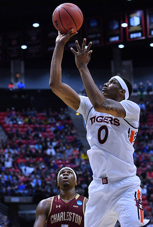 SAN DIEGO, CA - MARCH 16:  Auburn Tigers forward Horace Spencer (0) shoots against Charleston Cougars forward Jarrell Brantley (5) during a first round game of the Men's NCAA Basketball Tournament at Viejas Arena in San Diego, California. Auburn won 62-58.  (Photo by Sam Wasson)