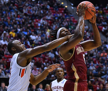 SAN DIEGO, CA - MARCH 16:  Charleston Cougars forward Jarrell Brantley (5) is fouled by Auburn Tigers guard Mustapha Heron (5)  during a first round game of the Men's NCAA Basketball Tournament at Viejas Arena in San Diego, California. Auburn won 62-58.  (Photo by Sam Wasson)