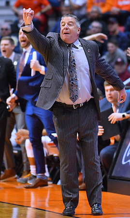 SAN DIEGO, CA - MARCH 16:  Auburn Tigers head coach Bruce Pearl calls a play for his team during a first round game of the Men's NCAA Basketball Tournament against the Charleston Cougars at Viejas Arena in San Diego, California. Auburn won 62-58.  (Photo by Sam Wasson)