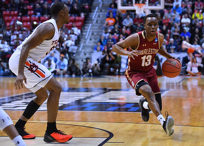 SAN DIEGO, CA - MARCH 16:  Charleston Cougars guard Joe Chealey (13) drives against Auburn Tigers guard Mustapha Heron (5) during a first round game of the Men's NCAA Basketball Tournament at Viejas Arena in San Diego, California. Auburn won 62-58.  (Photo by Sam Wasson)