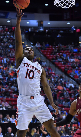 SAN DIEGO, CA - MARCH 16:  Auburn Tigers guard Davion Mitchell (10) gets a layup against the Charleston Cougars during a first round game of the Men's NCAA Basketball Tournament at Viejas Arena in San Diego, California. Auburn won 62-58.  (Photo by Sam Wasson)