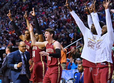 SAN DIEGO, CA - MARCH 16:  The Charleston Cougars bench cheers after the Cougars made a three-pointer against the Auburn Tigers during a first round game of the Men's NCAA Basketball Tournament at Viejas Arena in San Diego, California. Auburn won 62-58.  (Photo by Sam Wasson)