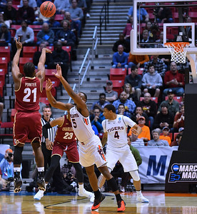 SAN DIEGO, CA - MARCH 16:  Charleston Cougars guard Marquise Pointer (21) shoots a three pointer against Auburn Tigers guard Mustapha Heron (5) during a first round game of the Men's NCAA Basketball Tournament at Viejas Arena in San Diego, California. Auburn won 62-58.  (Photo by Sam Wasson)