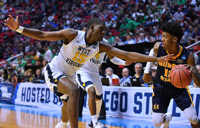 SAN DIEGO, CA - MARCH 16:  West Virginia Mountaineers forward Lamont West (15) pressures Murray State Racers guard Ja Morant (12) during a first round game of the Men's NCAA Basketball Tournament at Viejas Arena in San Diego, California.  (Photo by Sam Wasson)