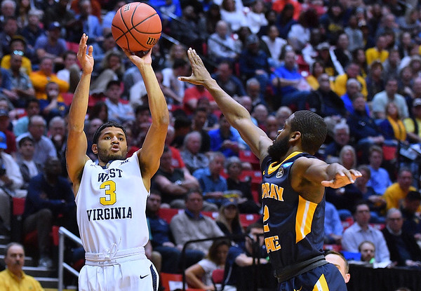 SAN DIEGO, CA - MARCH 16:  West Virginia Mountaineers guard James Bolden (3) shoots against Murray State Racers guard Jonathan Stark (2) during a first round game of the Men's NCAA Basketball Tournament at Viejas Arena in San Diego, California. West Virginia won 85-68.  (Photo by Sam Wasson)