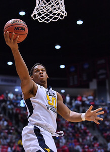 SAN DIEGO, CA - MARCH 16:  West Virginia Mountaineers forward Sagaba Konate (50) drives in for a layup against the Murray State Racers during a first round game of the Men's NCAA Basketball Tournament at Viejas Arena in San Diego, California. West Virginia won 85-68.  (Photo by Sam Wasson)