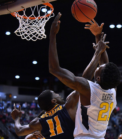 SAN DIEGO, CA - MARCH 16:  West Virginia Mountaineers forward Wesley Harris (21) battles for a rebound against Murray State Racers guard Shaq Buchanan (11) during a first round game of the Men's NCAA Basketball Tournament at Viejas Arena in San Diego, California.  (Photo by Sam Wasson)
