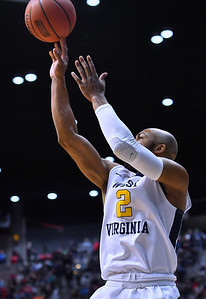 SAN DIEGO, CA - MARCH 16:  West Virginia Mountaineers guard Jevon Carter (2) shoots against the Murray State Racers during a first round game of the Men's NCAA Basketball Tournament at Viejas Arena in San Diego, California. West Virginia won 85-68.  (Photo by Sam Wasson)