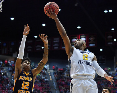 SAN DIEGO, CA - MARCH 16:  West Virginia Mountaineers guard Jevon Carter (2) drives in for a layup against Murray State Racers guard Ja Morant (12) during a first round game of the Men's NCAA Basketball Tournament at Viejas Arena in San Diego, California.  (Photo by Sam Wasson)