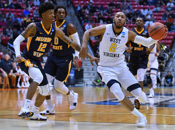 SAN DIEGO, CA - MARCH 16:  West Virginia Mountaineers guard Jevon Carter (2) drives against Murray State Racers guard Ja Morant (12) during a first round game of the Men's NCAA Basketball Tournament at Viejas Arena in San Diego, California. West Virginia won 85-68.  (Photo by Sam Wasson)