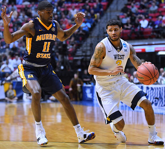 SAN DIEGO, CA - MARCH 16:  West Virginia Mountaineers guard James Bolden (3) drives against Murray State Racers guard Shaq Buchanan (11) during a first round game of the Men's NCAA Basketball Tournament at Viejas Arena in San Diego, California. West Virginia won 85-68.  (Photo by Sam Wasson)
