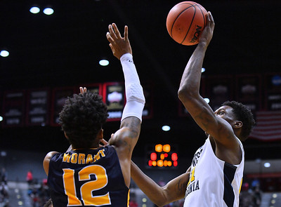 SAN DIEGO, CA - MARCH 16:  West Virginia Mountaineers forward Wesley Harris (21) shoots against Murray State Racers guard Ja Morant (12) during a first round game of the Men's NCAA Basketball Tournament at Viejas Arena in San Diego, California. West Virginia won 85-68.  (Photo by Sam Wasson)