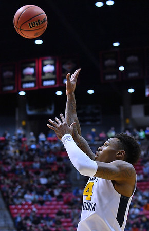 SAN DIEGO, CA - MARCH 16:  West Virginia Mountaineers guard Daxter Miles Jr. (4) shoots against the Murray State Racers during a first round game of the Men's NCAA Basketball Tournament at Viejas Arena in San Diego, California. West Virginia won 85-68.  (Photo by Sam Wasson)