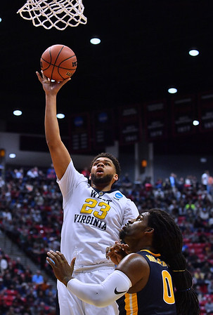 SAN DIEGO, CA - MARCH 16:  West Virginia Mountaineers forward Esa Ahmad (23) puts up a shot against Murray State Racers forward Terrell Miller Jr. (0) during a first round game of the Men's NCAA Basketball Tournament at Viejas Arena in San Diego, California.  (Photo by Sam Wasson)