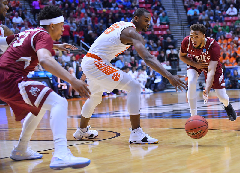 SAN DIEGO, CA - MARCH 16:  Johnny McCants #35 of the New Mexico State Aggies passes the ball to Zach Lofton #23 of the Aggies during a first round game of the Men's NCAA Basketball Tournament at Viejas Arena in San Diego, California. Clemson won 79-68.  (Photo by Sam Wasson)