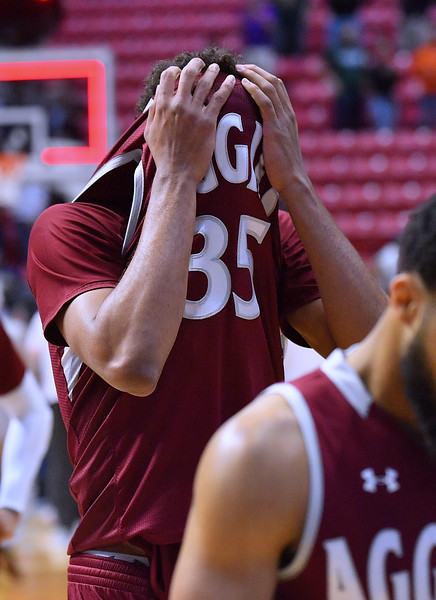 SAN DIEGO, CA - MARCH 16:  Johnny McCants #35 of the New Mexico State Aggies reacts after losing 79-68 to the Clemson Tigers during a first round game of the Men's NCAA Basketball Tournament at Viejas Arena in San Diego, California.  (Photo by Sam Wasson)