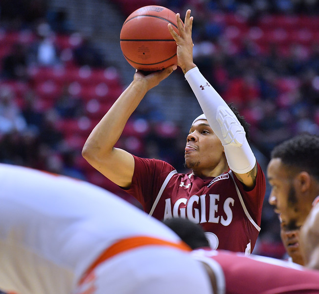 SAN DIEGO, CA - MARCH 16:  Zach Lofton #23 of the New Mexico State Aggies shoots a free throw against the Clemson Tigers during a first round game of the Men's NCAA Basketball Tournament at Viejas Arena in San Diego, California. Clemson won 79-68.  (Photo by Sam Wasson)
