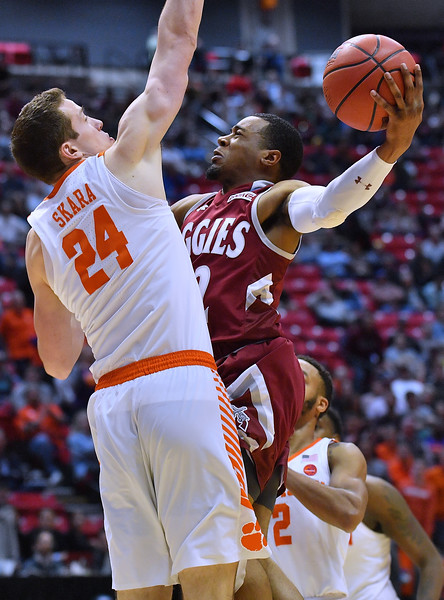 SAN DIEGO, CA - MARCH 16:  A.J. Harris #12 of the New Mexico State Aggies drives against David Skara #24 of the Clemson Tigers during a first round game of the Men's NCAA Basketball Tournament at Viejas Arena in San Diego, California. Clemson won 79-68.  (Photo by Sam Wasson)