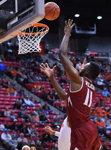 SAN DIEGO, CA - MARCH 16:  Johnathon Wilkins #11 of the New Mexico State Aggies shoots against Shelton Mitchell #4 of the Clemson Tigers during a first round game of the Men's NCAA Basketball Tournament at Viejas Arena in San Diego, California. Clemson won 79-68.  (Photo by Sam Wasson)