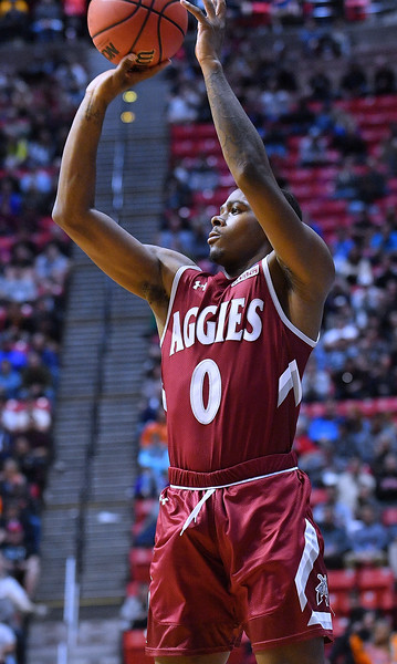 SAN DIEGO, CA - MARCH 16:  Keyon Jones #0 of the New Mexico State Aggies shoots against the Clemson Tigers during a first round game of the Men's NCAA Basketball Tournament at Viejas Arena in San Diego, California. Clemson won 79-68.  (Photo by Sam Wasson)