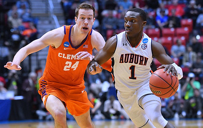 SAN DIEGO, CA - MARCH 18:  Jared Harper #1 of the Auburn Tigers drives against David Skara #24 of the Clemson Tigers during a second round game of the Men's NCAA Basketball Tournament at Viejas Arena in San Diego, California. Clemson won 84-53.  (Photo by Sam Wasson)
