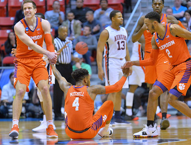 SAN DIEGO, CA - MARCH 18:  Shelton Mitchell #4 of the Clemson Tigers is helped up by teammates David Skara #24 and Marcquise Reed #2 during a second round game of the Men's NCAA Basketball Tournament at Viejas Arena in San Diego, California. Clemson won 84-53.  (Photo by Sam Wasson)