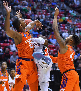 SAN DIEGO, CA - MARCH 18:  Bryce Brown #2 of the Auburn Tigers is fouled by Aamir Simms #25 of the Clemson Tigers as Shelton Mitchell #4 also plays defense during a second round game of the Men's NCAA Basketball Tournament at Viejas Arena in San Diego, California. Clemson won 84-53.  (Photo by Sam Wasson)