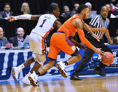 SAN DIEGO, CA - MARCH 18:  Marcquise Reed #2 of the Clemson Tigers drives up the court against Jared Harper #1 of the Auburn Tigers during a second round game of the Men's NCAA Basketball Tournament at Viejas Arena in San Diego, California. Clemson won 84-53.  (Photo by Sam Wasson)