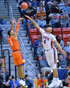 SAN DIEGO, CA - MARCH 18:  Marcquise Reed #2 of the Clemson Tigers shoots a three-pointer against Chuma Okeke #4 of the Auburn Tigers during a second round game of the Men's NCAA Basketball Tournament at Viejas Arena in San Diego, California. Clemson won 84-53.  (Photo by Sam Wasson)