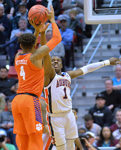 SAN DIEGO, CA - MARCH 18:  Shelton Mitchell #4 of the Clemson Tigers shoots against Jared Harper #1 of the Auburn Tigers during a second round game of the Men's NCAA Basketball Tournament at Viejas Arena in San Diego, California. Clemson won 84-53.  (Photo by Sam Wasson)
