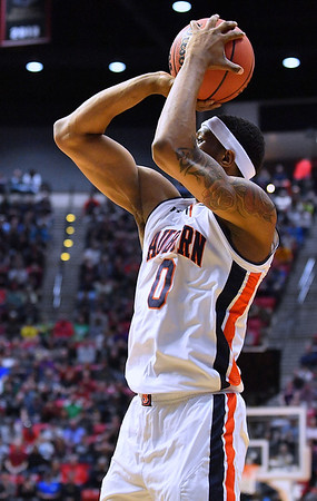 SAN DIEGO, CA - MARCH 18:  Horace Spencer #0 of the Auburn Tigers shoots against the Clemson Tigers during a second round game of the Men's NCAA Basketball Tournament at Viejas Arena in San Diego, California. Clemson won 84-53.  (Photo by Sam Wasson)