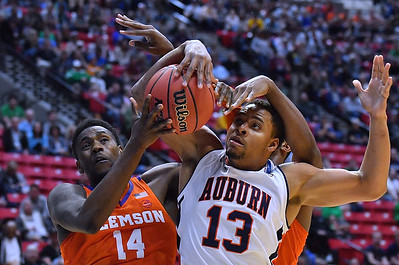 SAN DIEGO, CA - MARCH 18:  Elijah Thomas #14 of the Clemson Tigers and Desean Murray #13 of the Auburn Tigers battle for a rebound during a second round game of the Men's NCAA Basketball Tournament at Viejas Arena in San Diego, California. Clemson won 84-53.  (Photo by Sam Wasson)