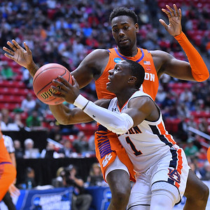 SAN DIEGO, CA - MARCH 18:  Jared Harper #1 of the Auburn Tigers drives against Elijah Thomas #14 of the Clemson Tigers during a second round game of the Men's NCAA Basketball Tournament at Viejas Arena in San Diego, California. Clemson won 84-53.  (Photo by Sam Wasson)