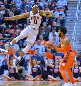 SAN DIEGO, CA - MARCH 18:  Horace Spencer #0 of the Auburn Tigers is caught in the air while defending Shelton Mitchell #4 of the Clemson Tigers during a second round game of the Men's NCAA Basketball Tournament at Viejas Arena in San Diego, California. Clemson won 84-53.  (Photo by Sam Wasson)