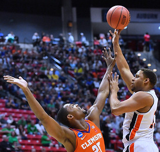 SAN DIEGO, CA - MARCH 18:  Desean Murray #13 of the Auburn Tigers shoots against Aamir Simms #25 of the Clemson Tigers during a second round game of the Men's NCAA Basketball Tournament at Viejas Arena in San Diego, California. Clemson won 84-53.  (Photo by Sam Wasson)