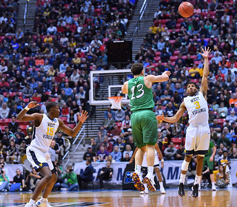 SAN DIEGO, CA - MARCH 18:  West Virginia Mountaineers guard James Bolden (3) contests a pass from Marshall Thundering Herd guard Jarrod West (13) during a second round game of the Men's NCAA Basketball Tournament at Viejas Arena in San Diego, California.  (Photo by Sam Wasson)